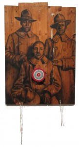 Whitfield Lovell American, b. 1959 At Home and Abroad, 2008 Conte crayon on wood with target, nails, and fabric Muskegon Museum of Art Purchased in honor of the 100th Anniversary of the Muskegon Museum of Art through the Art Acquisition Fund, the 100th Anniversary Art Acquisition Fund, the support of the Alcoa Foundation, and the gift of Dr. Anita Herald 2010.2
